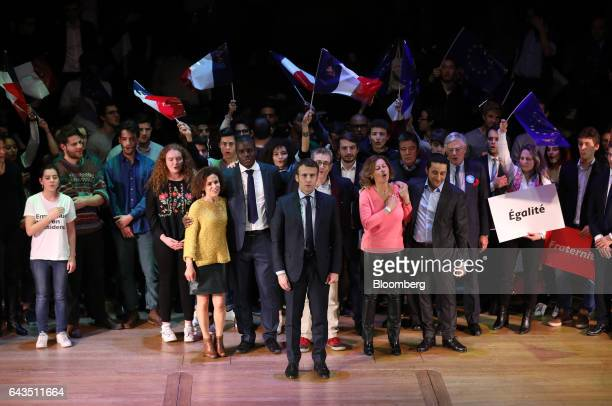 Emmanuel Macron French presidential candidate center sings the French national anthem 'La Marseillaise' with attendees after speaking at a campaign...