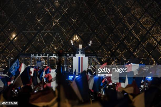 Emmanuel Macron French presidential candidate gestures before delivering a speech in front of the Pyramid at the Louvre Museum in Paris France on...