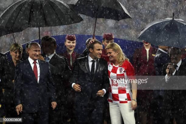 Emmanuel Macron Kolinda GrabarKitarovic Vladimir Putin during Russia 2018 World Cup final football match between France and Croatia at the Luzhniki...
