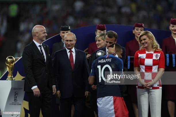 Emmanuel Macron Kylian Mbappe Vladimir Putin during Russia 2018 World Cup final football match between France and Croatia at the Luzhniki Stadium in...