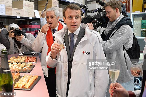 Emmanuel Macron Minister of Economics and Finances looks on as he visits Rungis International Market on December 23 2014 in Rungis France