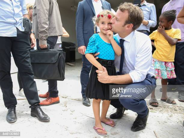 Emmanuel Macron President of France kisses a young girls of Grande Case during his visit after the passing of Hurricane Irma on September 12 2017 in...