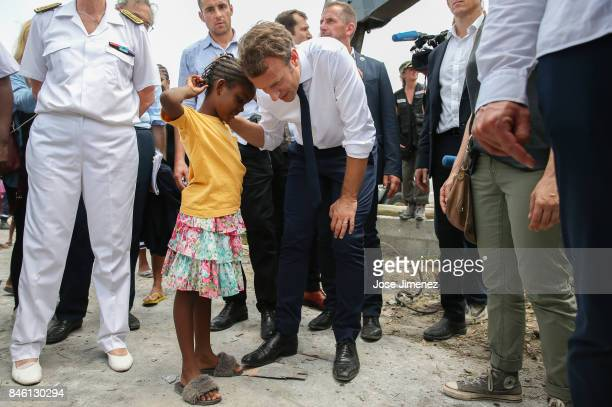 Emmanuel Macron President of France listens to a young girls of Grande Case during his visit after the passing of Hurricane Irma on September 12 2017...