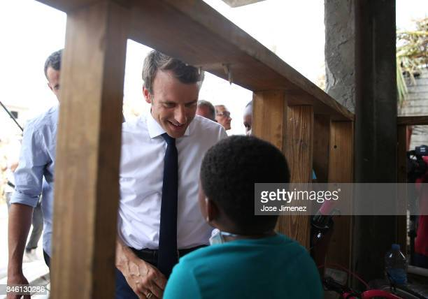 Emmanuel Macron President of France talks to a chiild resident of Grande Case during his visit after the passing of Hurricane Irma on September 12...