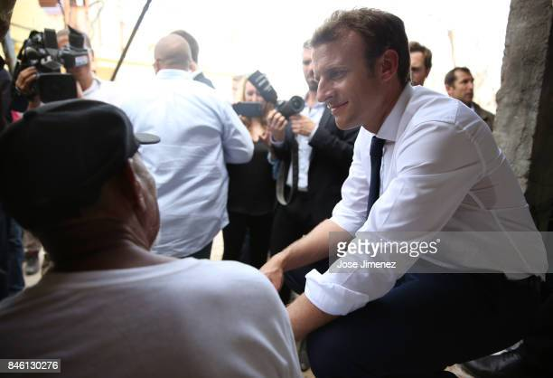Emmanuel Macron President of France talks to a local resident of Grande Case during his visit after the passing of Hurricane Irma on September 12...