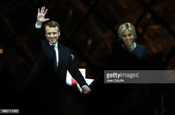 Emmanuel Macron with his wife Brigitte Macron celebrate his presidential election victory at Le Louvre on May 7 2017 in Paris France