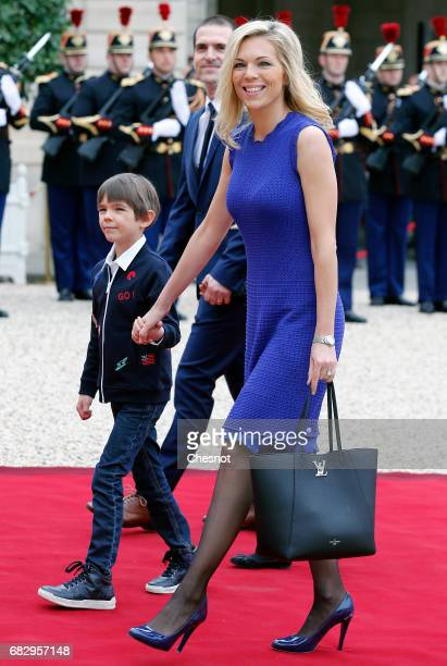 Emmanuel Macron's stepdaughter Laurence AuziereJourdan her husband Guillaume Jourdan and their children arrive at the Elysee Presidential Palace for...