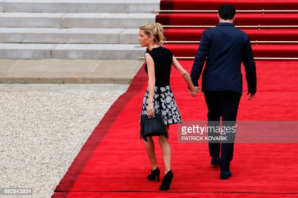 Emmanuel Macron's stepdaughter Tiphaine Auziere and her husband Antoine Choteau arrive at the Elysee presidential Palace to attend Emmanuel Macron's...
