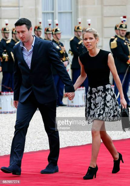 Emmanuel Macron's stepdaughter Tiphaine Auziere and her husband Antoine Choteau arrive at the Elysee Presidential Palace for the handover ceremony...
