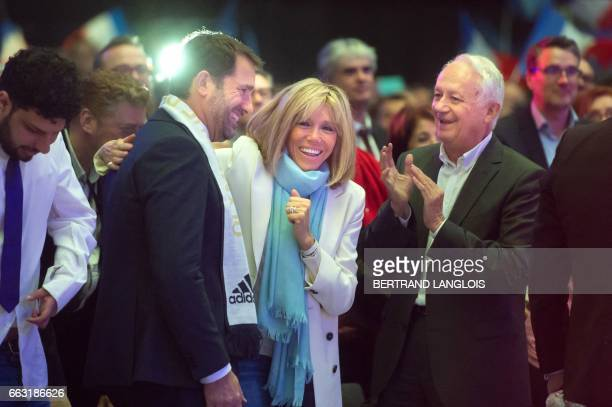 Emmanuel Macron's wife Brigitte Trogneux European Parliament member JeanMarie Cavada and socialist lawmaker Christophe Castaner take part in a...