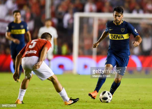 Emmanuel Mas of Boca Juniors drives the ball under pressure of Nicolas Domingo of Independiente during a match between Independiente and Boca Juniors...