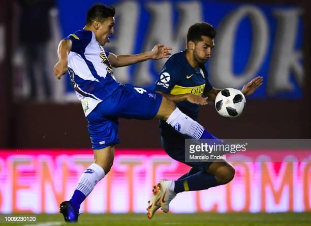 Emmanuel Mas of Boca Juniors fights for the ball with Emanuel Urquiza of Alvarado during a match between Boca Juniors and Alvarado as part of Round...