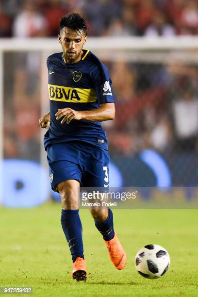 Emmanuel Mas of Boca Juniors kicks the ball during a match between Independiente and Boca Juniors as part of Superliga 2017/18 on April 15 2018 in...