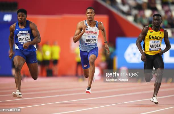 Emmanuel Matadi of Liberia Zharnel Hughes of Great Britain and Joseph Paul Amoah of Ghana compete in the Men's 100 metres heats during day one of...