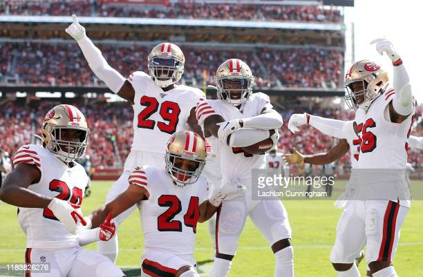 Emmanuel Moseley of the San Francisco 49ers and his defensive teammates celerabate an interception in the second quarter against the Carolina...