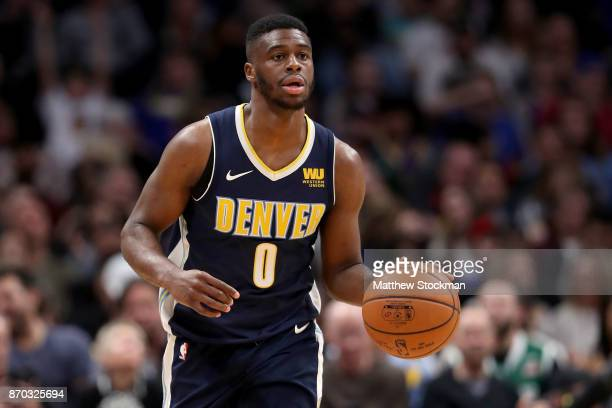 Emmanuel Mudiay of the Denver Nuggets brings the ball down the court against the Golden State Warriors at the Pepsi Center on November 4 2017 in...