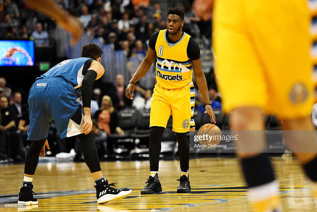 Emmanuel Mudiay (0) of the Denver Nuggets brings the ball up court against Ricky Rubio (9) of the Minnesota Timberwolves during the first quarter. The Denver Nuggets hosted the Minnesota Timberwolves on Wednesday, December 28, 2016.