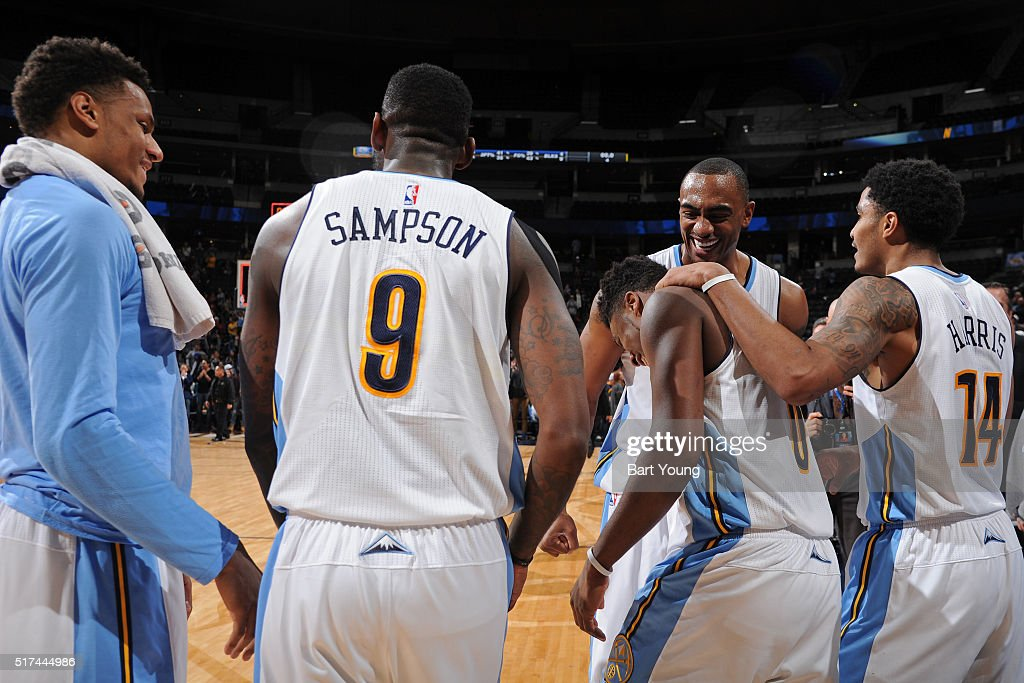 Emmanuel Mudiay #0 of the Denver Nuggets celebrates with his teammates after hitting the game winning three point shot against the Philadelphia 76ers on March 23, 2016 at the Pepsi Center in Denver, Colorado.
