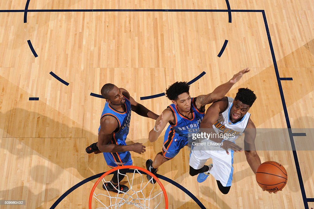 Emmanuel Mudiay #0 of the Denver Nuggets drives to the basket against the Oklahoma City Thunder on January 19, 2016 at the Pepsi Center in Denver, Colorado.