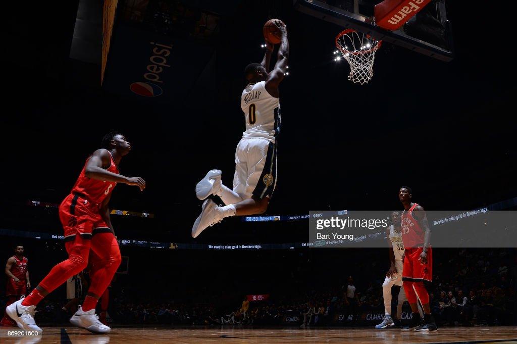 Emmanuel Mudiay #0 of the Denver Nuggets drives to the basket against the Toronto Raptors on November 1, 2017 at the Pepsi Center in Denver, Colorado.