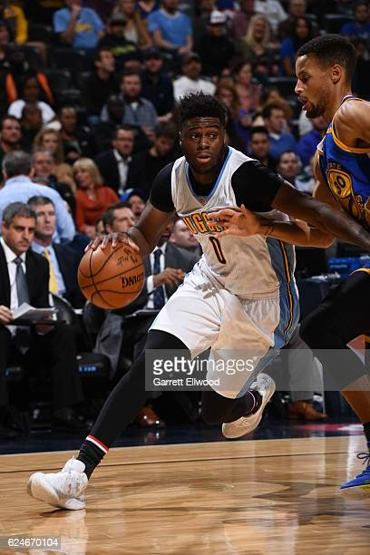 Emmanuel Mudiay of the Denver Nuggets drives to the basket during the game against the Golden State Warriors on November 10 2016 at the Pepsi Center...