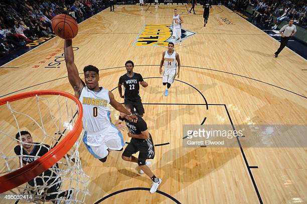 Emmanuel Mudiay of the Denver Nuggets dunks against the Minnesota Timberwolveson October 30 2015 at the Pepsi Center in Denver Colorado NOTE TO USER...