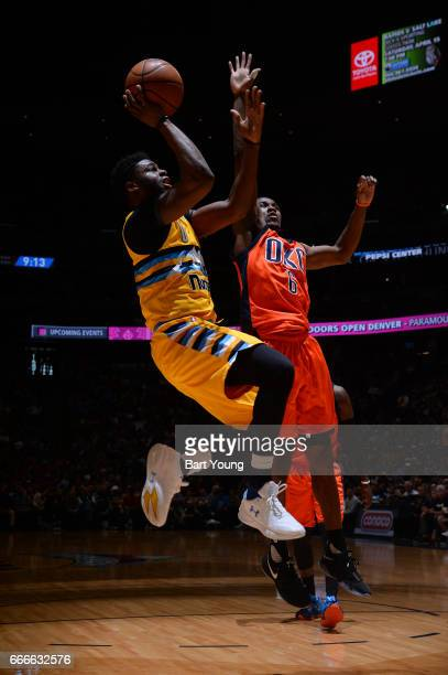 Emmanuel Mudiay of the Denver Nuggets goes to the basket against the Oklahoma City Thunder on April 9 2017 at the Pepsi Center in Denver Colorado...