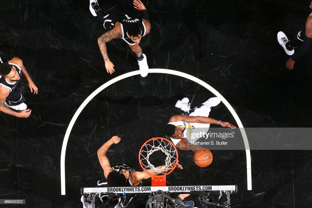 Emmanuel Mudiay #0 of the Denver Nuggets goes to the basket against the Brooklyn Nets on October 29, 2017 at Barclays Center in Brooklyn, New York.