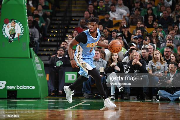 Emmanuel Mudiay of the Denver Nuggets handles the ball against the Boston Celtics on November 6 2016 at the TD Garden in Boston Massachusetts NOTE TO...