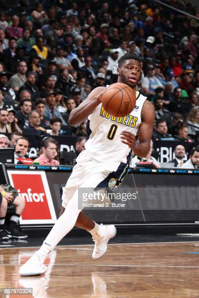 Emmanuel Mudiay of the Denver Nuggets handles the ball against the Brooklyn Nets on October 29 2017 at Barclays Center in Brooklyn New York NOTE TO...