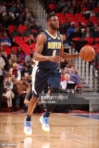 Emmanuel Mudiay of the Denver Nuggets handles the ball against the Detroit Pistons on December 12 2017 at Little Caesars Arena in Detroit Michigan...