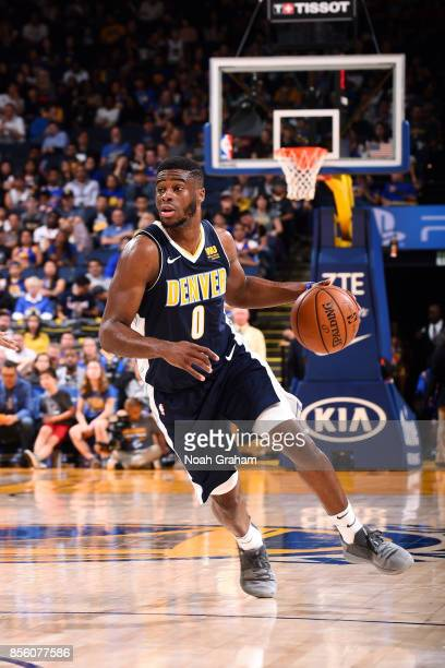 Emmanuel Mudiay of the Denver Nuggets handles the ball during the game against the Golden State Warriors during a preseason game on September 30 2017...