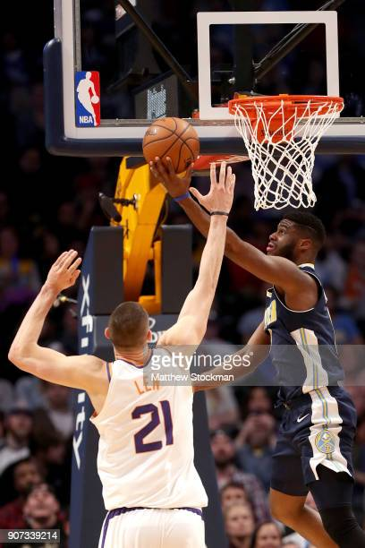 Emmanuel Mudiay of the Denver Nuggets puts up a shot against Alex Len of the Phoenix Suns at the Pepsi Center on January 19 2018 in Denver Colorado...