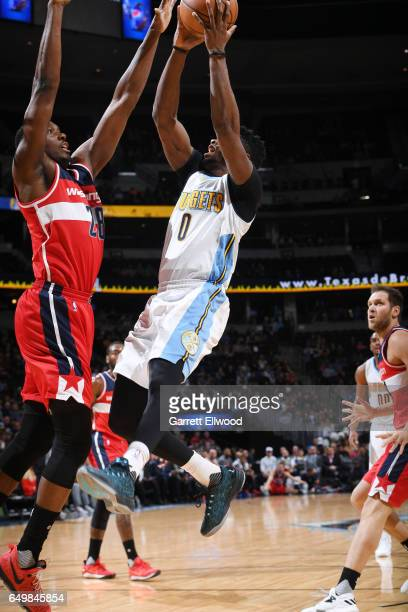 Emmanuel Mudiay of the Denver Nuggets shoots the ball against Ian Mahinmi of the Washington Wizards during the game on March 8 2017 at the Pepsi...