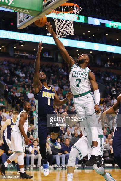 Emmanuel Mudiay of the Denver Nuggets shoots the ball against Jaylen Brown of the Boston Celtics during the first half at TD Garden on December 13...