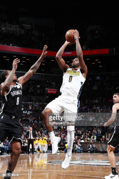 Emmanuel Mudiay of the Denver Nuggets shoots the ball against the Brooklyn Nets on October 29 2017 at Barclays Center in Brooklyn New York NOTE TO...
