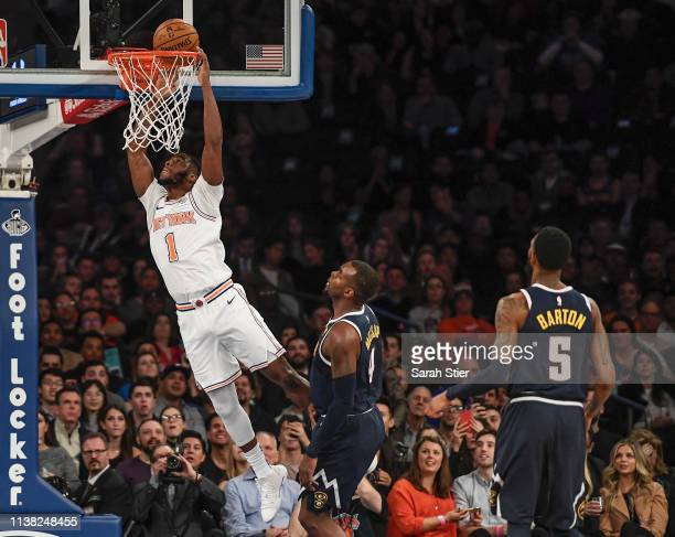 Emmanuel Mudiay of the New York Knicks attempts a slam dunk during the first half of the game against the Denver Nuggets at Madison Square Garden on...