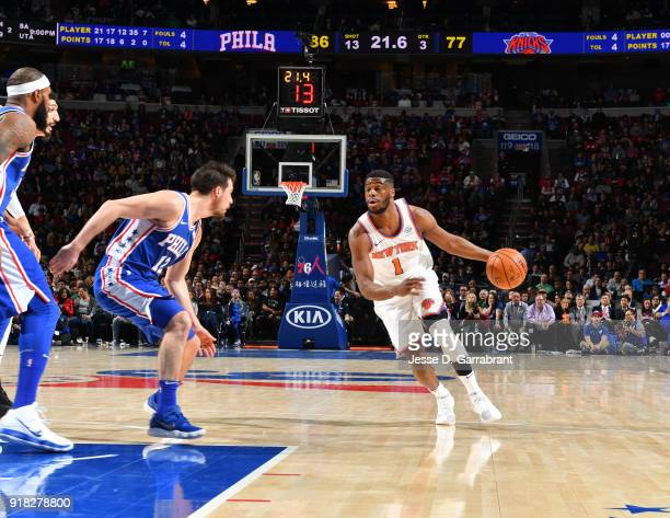Emmanuel Mudiay of the New York Knicks controls the ball against the Philadelphia 76ers at Wells Fargo Center on February 12 2018 in Philadelphia...