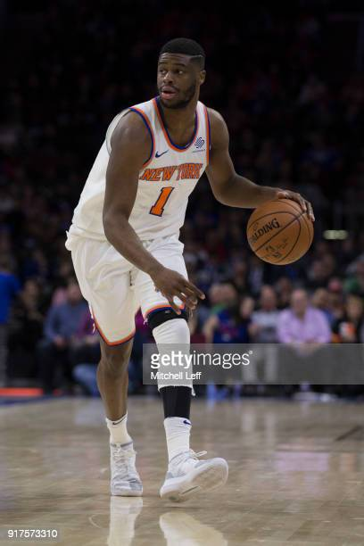 Emmanuel Mudiay of the New York Knicks dribbles the ball against the Philadelphia 76ers in the third quarter at the Wells Fargo Center on February 12...