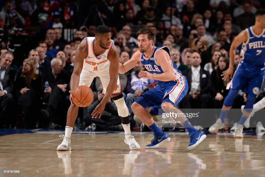 Emmanuel Mudiay #1 of the New York Knicks dribbles the ball while guarded by T.J. McConnell #12 of the Philadelphia 76ers on February 12, 2018 in Philadelphia, Pennsylvania at Wells Fargo Center.
