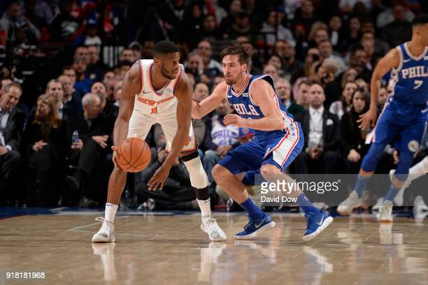 Emmanuel Mudiay of the New York Knicks dribbles the ball while guarded by TJ McConnell of the Philadelphia 76ers on February 12 2018 in Philadelphia...