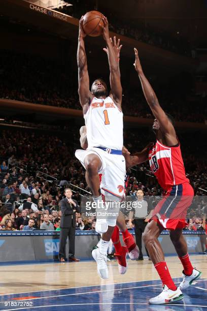 Emmanuel Mudiay of the New York Knicks goes up for a dunk against the Washington Wizards on February 14 2018 at Madison Square Garden in New York NY...