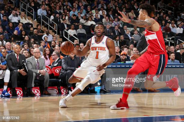 Emmanuel Mudiay of the New York Knicks handles the ball against the Washington Wizards on February 14 2018 at Madison Square Garden in New York NY...