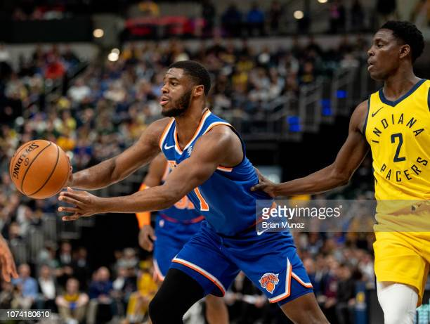 Emmanuel Mudiay of the New York Knicks passes the ball away from Darren Collison of the Indiana Pacers during the first half of the game at Bankers...