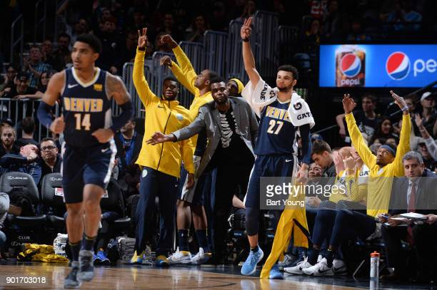 Emmanuel Mudiay Paul Millsap and Jamal Murray of the Denver Nuggets react during the game against the Utah Jazz on January 5 2018 at the Pepsi Center...