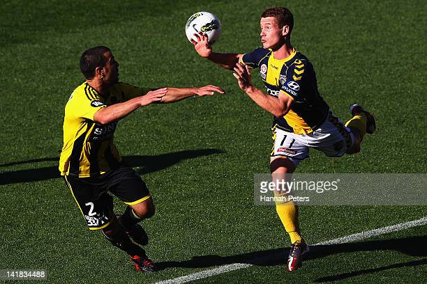 Emmanuel Muscat of the Phoenix competes with Oliver Bozanic of the Mariners during the round 25 ALeague match between the Wellington Phoenix and the...