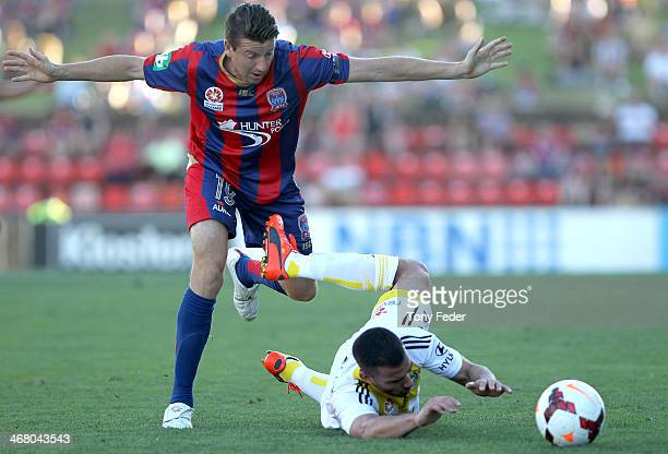 Emmanuel Muscat of the Phoenix is tackled by Michael Bridges of the Jets during the round 18 ALeague match between the Newcastle Jets and Wellington...