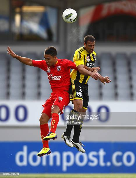 Emmanuel Muscat of the Wellington Phoenix and Iain Ramsay of Adelaide United header the ball during the round seven A-League match between the...