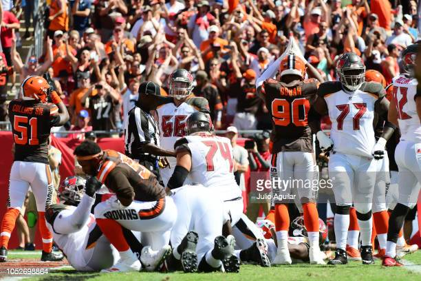 Emmanuel Ogbah of the Cleveland Browns and fans signal a safety against the Tampa Bay Buccaneers on October 21 2018 at Raymond James Stadium in Tampa...