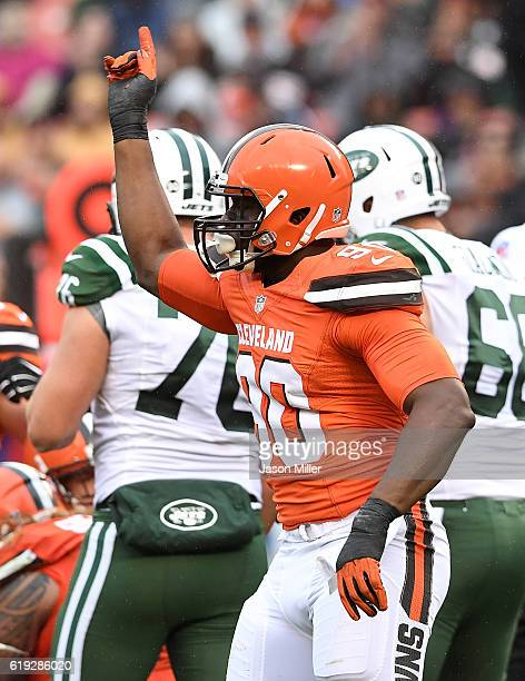 Emmanuel Ogbah of the Cleveland Browns reacts after sacking Ryan Fitzpatrick of the New York Jets during the first quarter at FirstEnergy Stadium on...